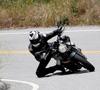Cuál es la postura correcta al manejar una moto